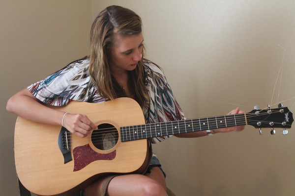 """Nicole Winkler of Anderson practices her guitar in preparation for recording her cousin's song """"My Heart's Beating Country,"""" which she hopes to release to radio in June.<br /> <br /> Photographer's Name: Nicole Winkler<br /> Photographer's City and State: Anderson, Ind."""