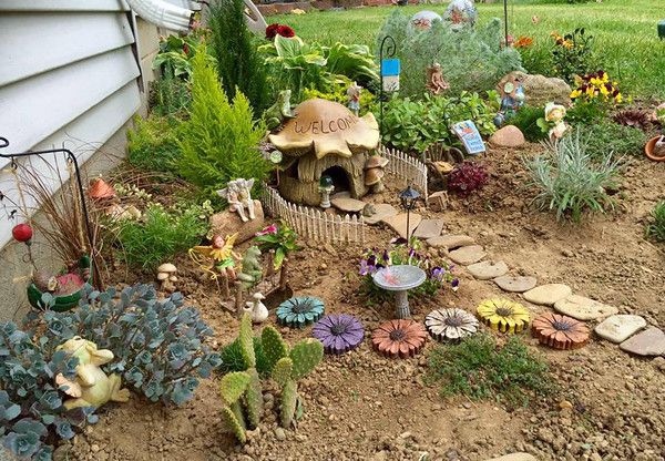 My outdoor fairy garden near Perkinsville, Ind.<br /> <br /> Photographer's Name: Janet Neese-Hoffman<br /> Photographer's City and State: Frankton, Ind.