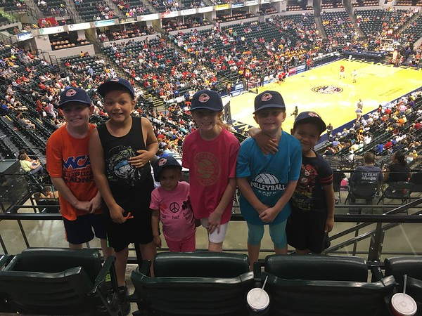 Ryan, Natalie, and Kendall Long and Teddy, Franklin, and Charlotte Cambridge at an Indiana Fever basketball game.<br /> <br /> Photographer's Name: Carrie  Long <br /> Photographer's City and State: Alexandria , Ind.