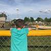 Carter Sovern, age 7, watches his cousin play a baseball game in Alexandria.<br /> <br /> Photographer's Name: Carrie Long<br /> Photographer's City and State: Alexandria, Ind.