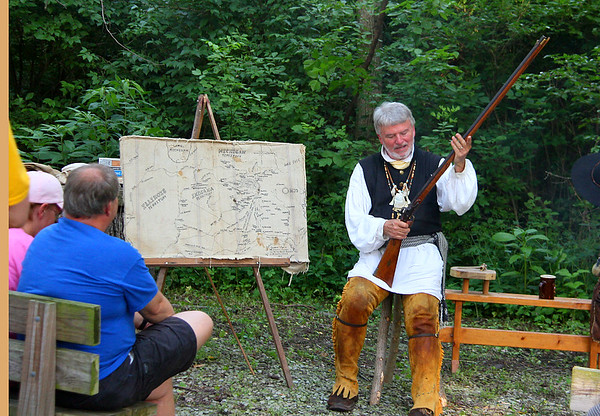 Interpreter Earl Evans explaining the black powder gun to Mounds Park visitors.<br /> <br /> Photographer's Name: Jerry  Byard<br /> Photographer's City and State: Anderson, Ind.