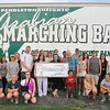 Pendleton Heights Band Program receives a $4,000 grant from NineStar Communications Operation Round Up to assist with new marching band uniforms.<br /> <br /> Photographer's Name: Brian Gust<br /> Photographer's City and State: Pendleton, Ind.