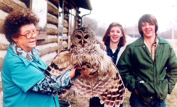 Anderson resident Dick Davisson provided this photo, of an owl that was rescued from an illegal trap about 35 years ago near Perkinsville. From left to right are wildlife expert Pauline Kiger, Davisson's daughter Jenny and son Bill.<br /> <br /> Photographer's Name: Dick Davisson<br /> Photographer's City and State: Anderson, Ind.