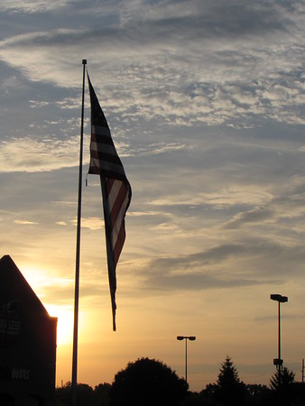 Flag at sunset.<br /> <br /> Photographer's Name: Harry Van Noy<br /> Photographer's City and State: Lafayette Township, Ind.