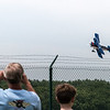 Spectators watch a low altitude fly-by during the Airshow held on June 17.<br /> <br /> Photographer's Name: Bert Happel<br /> Photographer's City and State: Anderson, Ind.