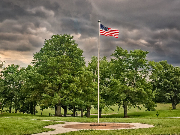 The flag against a stormy sky<br /> <br /> Photographer's Name: Terry Lynn  Ayers<br /> Photographer's City and State: Anderson, Ind.