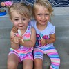 Cousins Savannah Davis and Maddie Morrison, both age 2, enjoying popsicles.<br /> <br /> Photographer's Name: Linda Horn<br /> Photographer's City and State: Anderson, Ind.