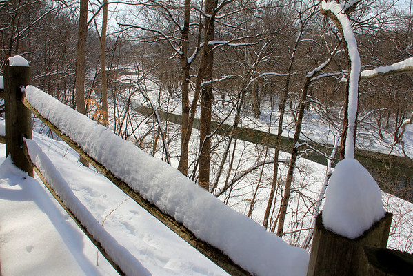 A snow-covered railing along Trail 5 at Mounds State Park on a sunny day after the big snow.<br /> <br /> Photographer's Name: Jerry  Byard<br /> Photographer's City and State: Anderson, Ind.