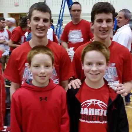 Twelve-year-old twins Trevor and Tyler McCorkle pose with Frankton high school basketball players Connor and Cameron Bates after the Eagles' recent sectional win.<br /> <br /> Photographer's Name: Carrie McCorkle<br /> Photographer's City and State: Frankton, Ind.