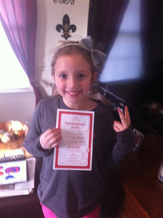 My granddaughter Lilly McIntyre showing her art award from Indiana Christian Academy.<br /> <br /> Photographer's Name: Tina Snyder<br /> Photographer's City and State: Anderson, Ind.