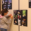 One of the young folks that attended the photo show at Mounds Park is voting on a people's choice photo.<br /> <br /> Photographer's Name: Jerry Byard<br /> Photographer's City and State: Anderson, Ind.