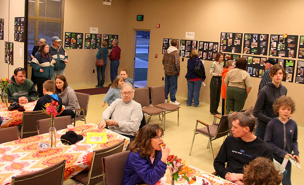 Several people attended the photo and poetry show at Mounds Park on Saturday evening.<br /> <br /> Photographer's Name: Jerry Byard<br /> Photographer's City and State: Anderson, Ind.