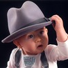 Nash Austin, age 9 months, tries on a hat.<br /> <br /> Photographer's Name: Suzanne Ruffer<br /> Photographer's City and State: Middletown, Ind.