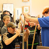 Some folks creating a walking stick at the workshop at Mounds Park on Saturday.<br /> <br /> Photographer's Name: Jerry  Byard<br /> Photographer's City and State: Anderson, Ind.