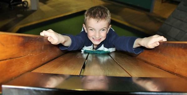Grandson J.J. sliding backwards down an antique slide in Muncie.<br /> <br /> Photographer's Name: Rebecca Reding<br /> Photographer's City and State: Anderson, Ind.