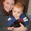 Meeting newborn puppies. My daughter Wesley and grandson Chase. <br /> <br /> Photographer's Name: Deborah Allen<br /> Photographer's City and State: Anderson, Ind.