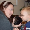 Meeting newborn puppies. My daughter Wesley and grandson Chase.<br /> <br /> Photographer's Name: Deborah Allen<br /> Photographer's City and State: Anderson, Ind.