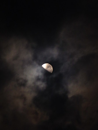The moon, peeking through the clouds.<br /> <br /> Photographer's Name: Harry Van Noy<br /> Photographer's City and State: Lafayette Township, Ind.