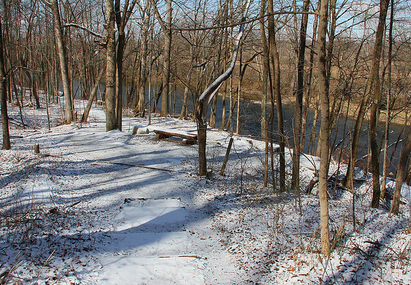 Snowy trail at Mounds Park in the morning sun.<br /> <br /> Photographer's Name: Jerry Byard<br /> Photographer's City and State: Anderson, Ind.