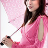 Photo of a young woman with pink umbrella taken by Barbara Grimball recently.<br /> <br /> Photographer's Name: Barbara Grimball<br /> Photographer's City and State: Anderson, Ind.