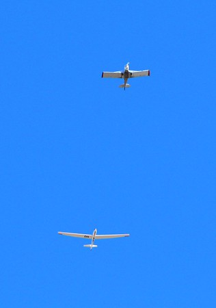 A plane towing a glider in northern Madison County.<br /> <br /> Photographer's Name: Brian Fox<br /> Photographer's City and State: Anderson, Ind.