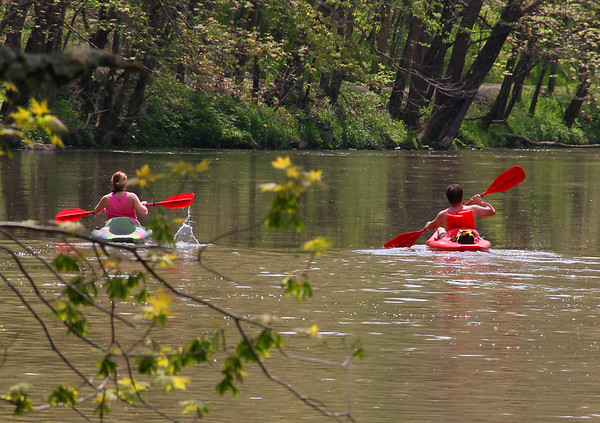 Two people were kayaking White River through Mounds Park on a warm afternoon.<br /> <br /> Photographer's Name: Jerry Byard<br /> Photographer's City and State: Anderson, Ind.