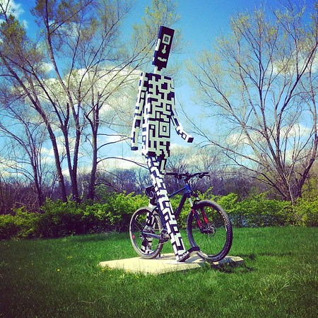 My husband Patrick bikes all over and uses Anderson's trails. He recently took this photo at Shadyside Park, featuring his bike beside a Walking Man.<br /> <br /> Photographer's Name: Linda Manderson<br /> Photographer's City and State: Anderson, Ind.