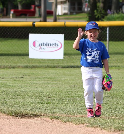 Addie Mac Voiles waves to her fans during her recent baseball game.<br /> <br /> Photographer's Name: Brian Fox<br /> Photographer's City and State: Anderson, Ind.