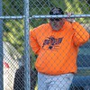 Coach Aaron Higgins watches his Astros team play at Brooklyn Little League.<br /> <br /> Photographer's Name: Brian Fox<br /> Photographer's City and State: Anderson, Ind.