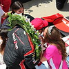 2015 500 Festival Queen Ali Mathena kisses Indianapolis 500 winner Juan Pablo Montoya after the race.<br /> <br /> Photographer's Name: Madeline May<br /> Photographer's City and State: Pendleton, Ind.
