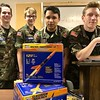 Civil Air Patrol cadets from the Anderson Composite Squadron prep for a presentation on model rocketry.<br /> <br /> Photographer's Name: Davina Martin<br /> Photographer's City and State: Muncie, Ind.