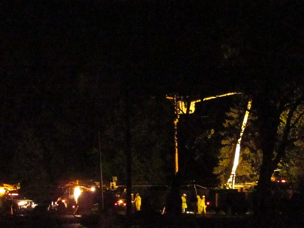 A recent 2 a.m. power crew putting up a new telephone pole.<br /> <br /> Photographer's Name: Harry Van Noy<br /> Photographer's City and State: Lafayette Township., Ind.
