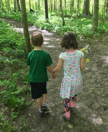Twins Madelyn and Brayden Ambler taking a walk in the woods on their 6th birthday.<br /> <br /> Photographer's Name: Karen Ambler<br /> Photographer's City and State: Anderson, Ind.