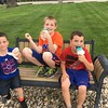 Bennett Sovern, Ryan Long, and Carter Sovern enjoy an ice cream cone at Gaithersburg Family Resources in Alexandria.<br /> <br /> Photographer's Name: Carrie Long <br /> Photographer's City and State: Alexandria, Ind.