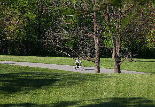 A lone biker at Mounds Park enjoying the evening.<br /> <br /> Photographer's Name: Jerry Byard<br /> Photographer's City and State: Anderson, Ind.