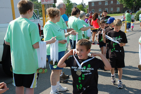 Every child received a medal at the Saint John's-YMCA Kidz Marathon.<br /> <br /> Photographer's Name: Randy Titus<br /> Photographer's City and State: Anderson, IN