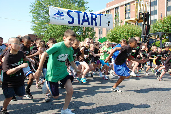 Youngsters blast off the starting line during the Saint John's-YMCA Kidz Marathon Saturday.<br /> <br /> Photographer's Name: Randy Titus<br /> Photographer's City and State: Anderson, IN