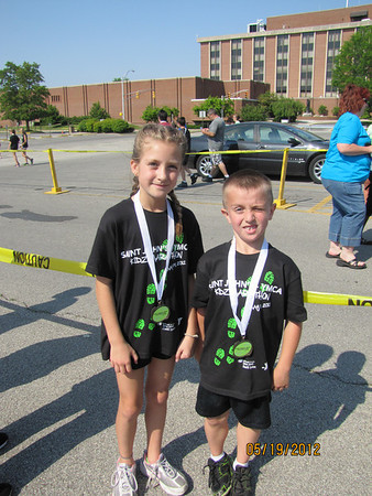 Jada and Jackson Mullins after the Kidz Marathon with their medals.<br /> <br /> Photographer's Name: JoAnna Mullins<br /> Photographer's City and State: Anderson, IN