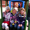 Lilly McIntyre and her friends Layla and Maddi enjoying a train ride at Christmas in Pendleton.<br /> <br /> Photographer's Name: Tina Snyder<br /> Photographer's City and State: Anderson, Ind.