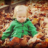 Great-granddaughter Charlotte enjoying the fall leaves. <br /> <br /> Photographer's Name: Jennie Troxell<br /> Photographer's City and State: Markleville, Ind.