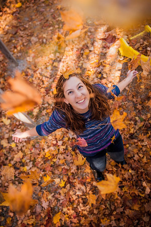 My friend Mary Slonim throwing leaves.<br /> <br /> Photographer's Name: Terry Lynn Ayers<br /> Photographer's City and State: Anderson, Ind.