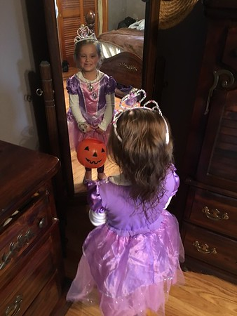 My granddaughter posing in the same mirror as her mommy, 24 years later.<br /> <br /> Photographer's Name: Tammy McCord<br /> Photographer's City and State: Anderson, Ind.