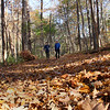 Two hikers enjoying the leaf-covered trail at Mounds Park on a beautiful Fall Saturday.<br /> <br /> Photographer's Name: Jerry Byard<br /> Photographer's City and State: Anderson, Ind.