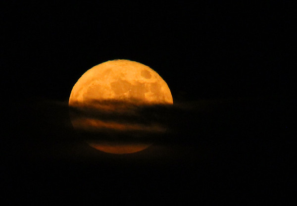 The super moon on Monday evening almost clear of the clouds,<br /> <br /> Photographer's Name: Jerry Byard<br /> Photographer's City and State: Anderson, Ind.