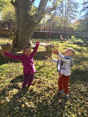 My granddaughter, Ashlynn, and grandson, Elijah, having a blast playing in the leaves!<br /> <br /> Photographer's Name: Tammy McCord<br /> Photographer's City and State: Anderson, Ind.