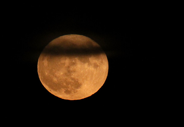 Super moon with a wisp of cloud cover.<br /> <br /> Photographer's Name: Jerry Byard<br /> Photographer's City and State: Anderson, Ind.