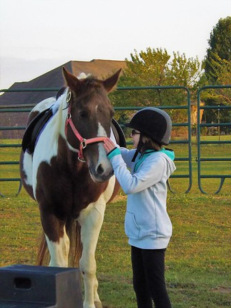A young rider talking to her horse at Moon Rise Farms.<br /> <br /> Photographer's Name: J.R. Rosencrans<br /> Photographer's City and State: Alexandria, Ind.