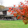 The grist mill at Spring Mill State Park with a pretty colorful tree.<br /> <br /> Photographer's Name: Jerry Byard<br /> Photographer's City and State: Anderson, Ind.