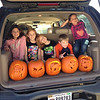 Cousins Chloe Cuneo, 11, Natalie Long, 8, Kendall Long, 5, Ryan Long, 7, and Avery Cuneo, 7, show off the results of their pumpkin carving over the weekend.<br /> <br /> Photographer's Name: Carrie Long<br /> Photographer's City and State: Alexandria, Ind.