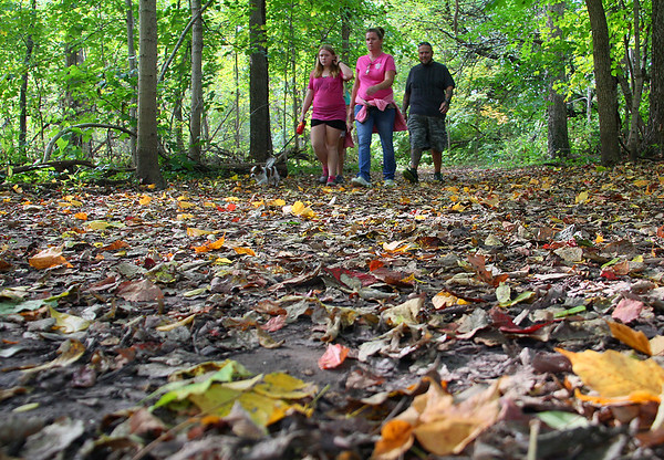 Local hikers on trail 5 at Mounds Park on a leaf covered trail.<br /> <br /> Photographer's Name: Jerry Byard<br /> Photographer's City and State: Anderson, Ind.